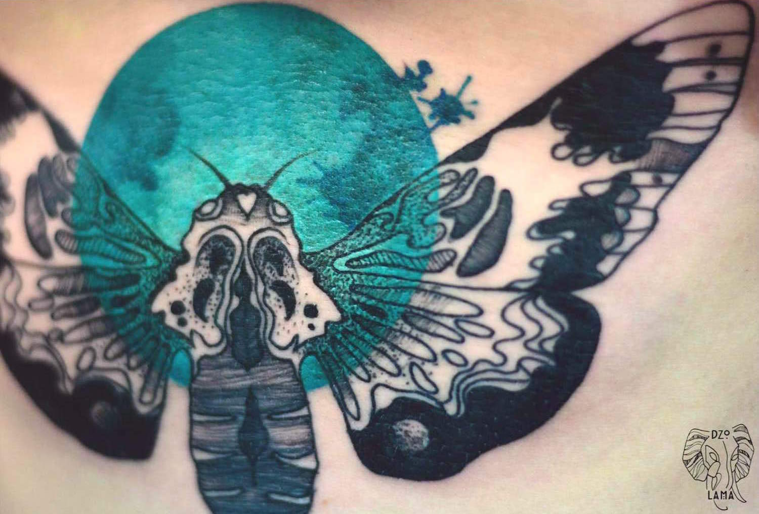 closeup of moth tattoo