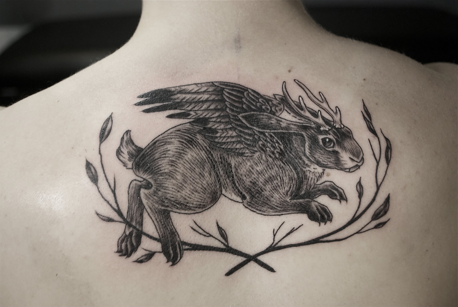 rabbit with wing tattoo by Alison Woodward