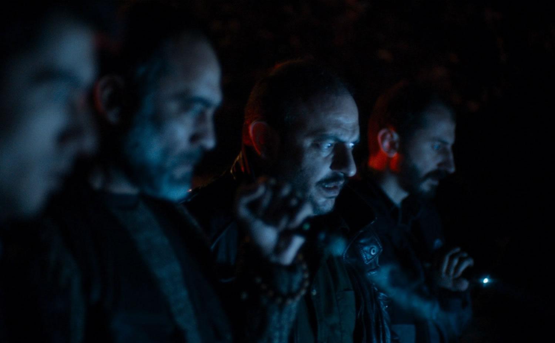 blue light on men's faces, in baskin movie