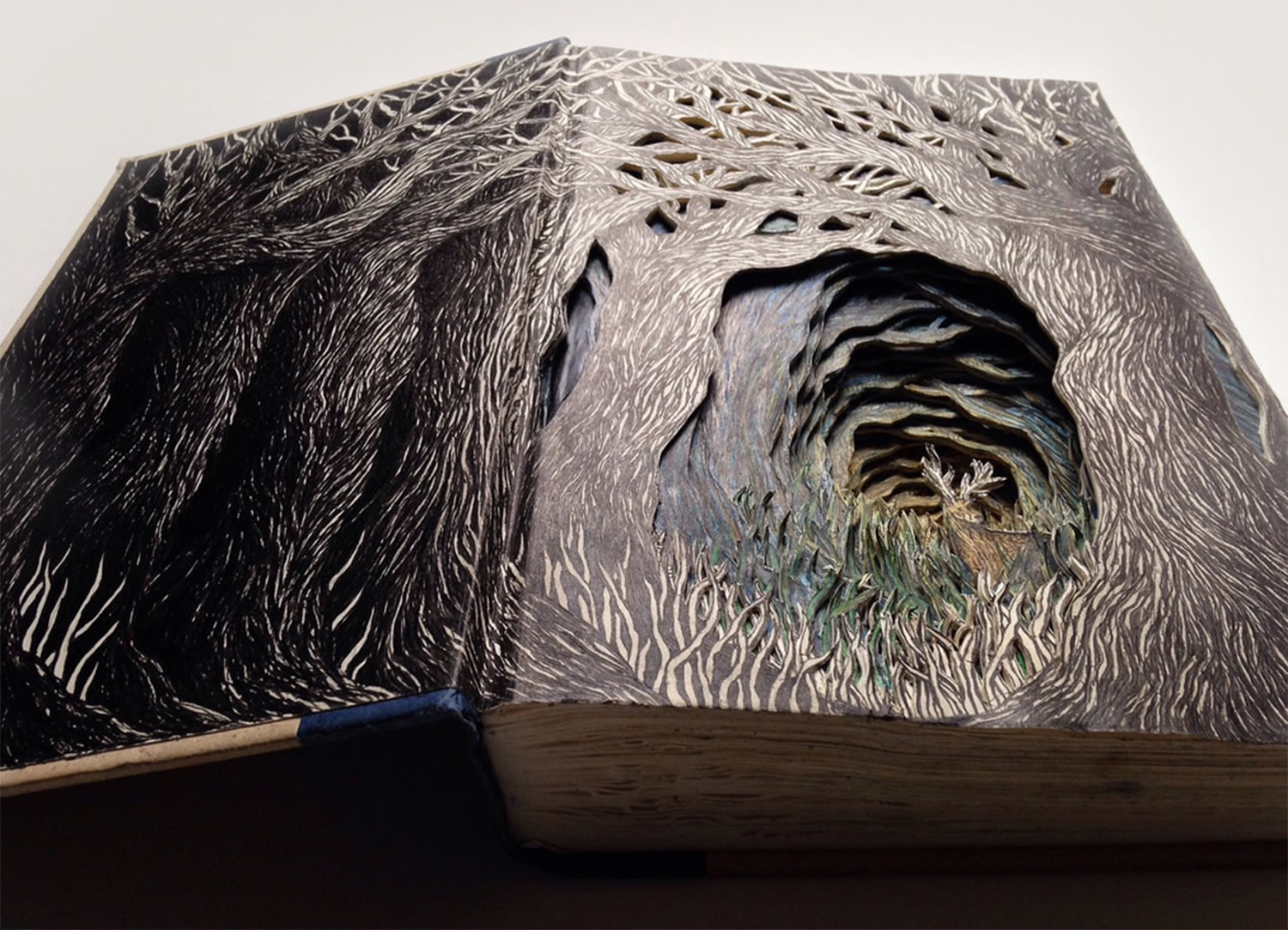 altered book, paper art by Isobelle Ouzman