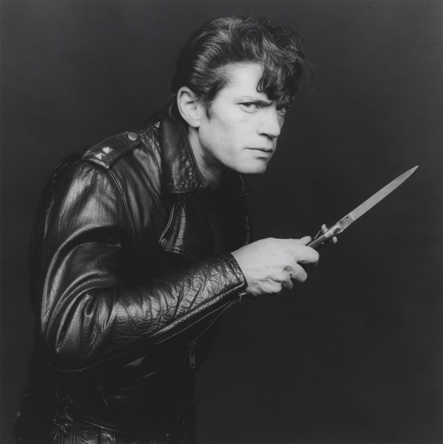 self-portrait, leather jacket and knife
