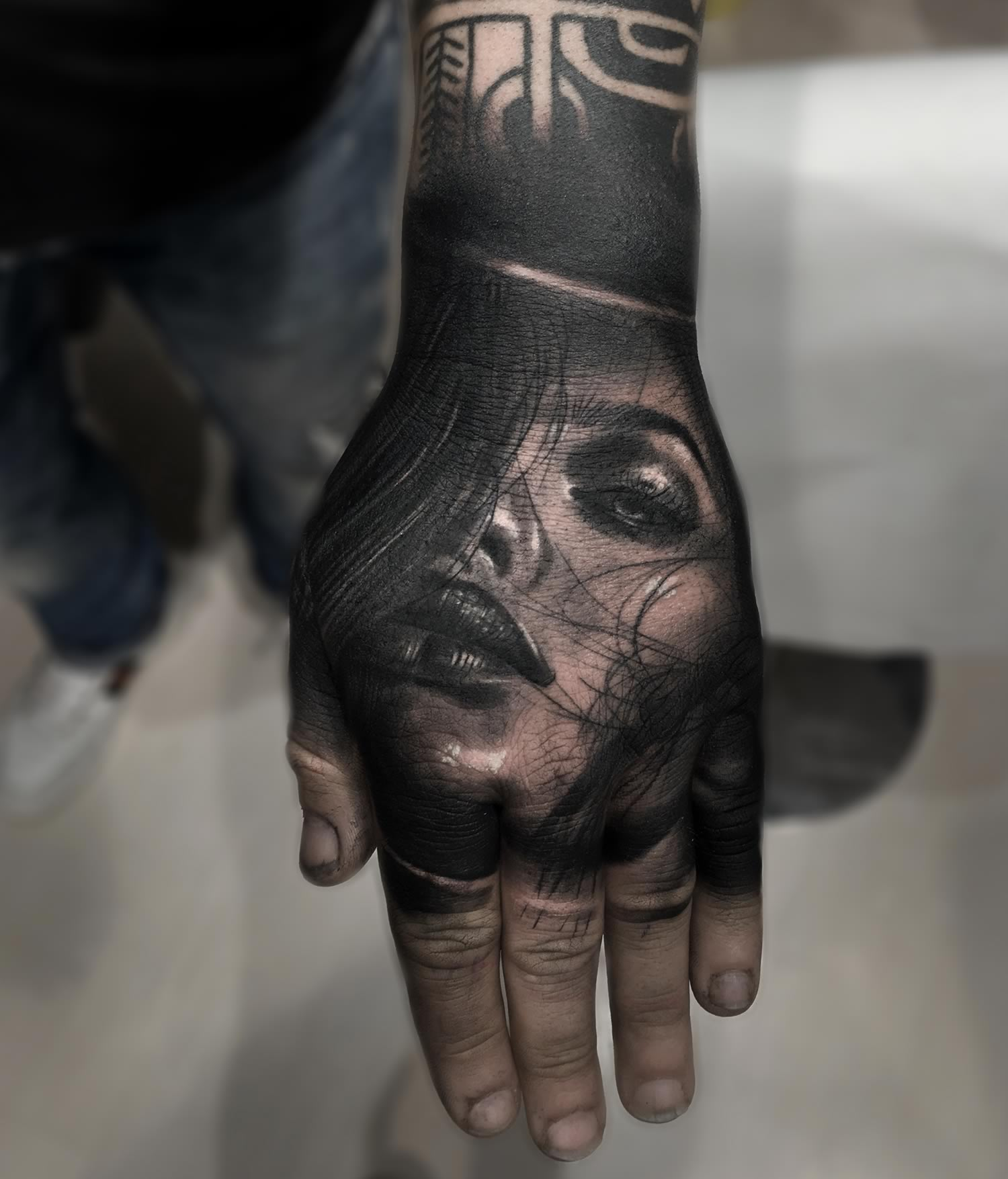 woman portrait tattooed on hand. hand tattoo