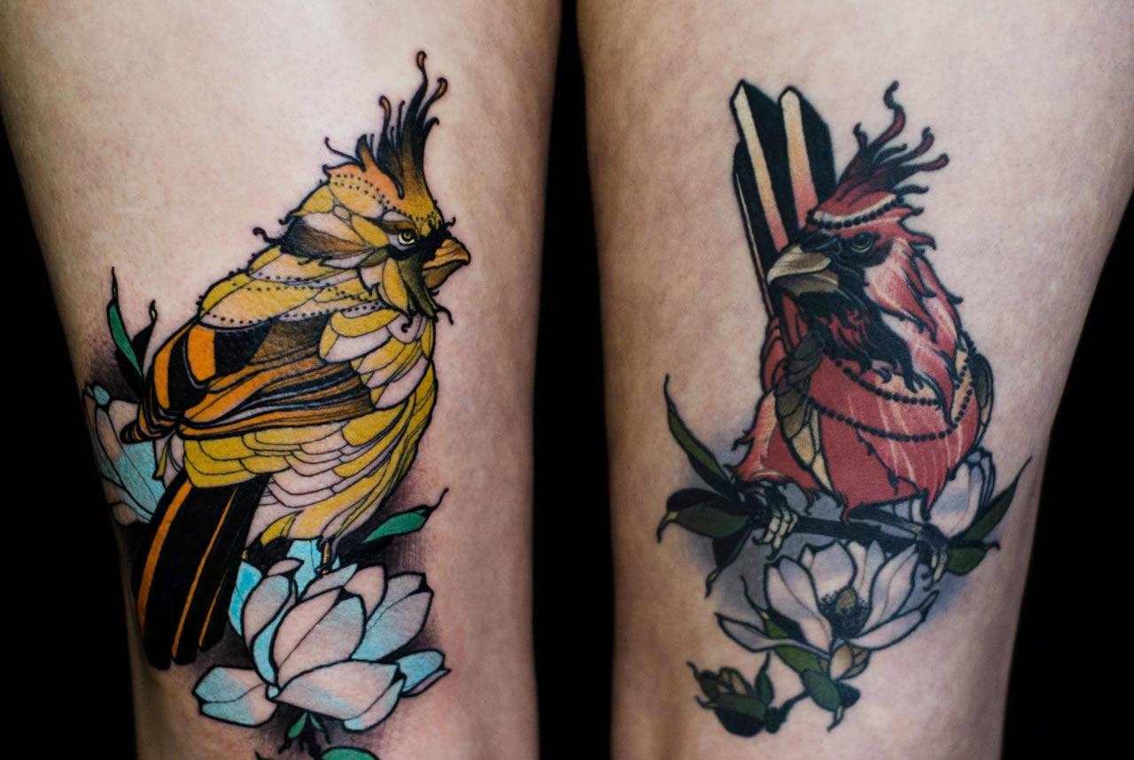 bird tattoos on thighs