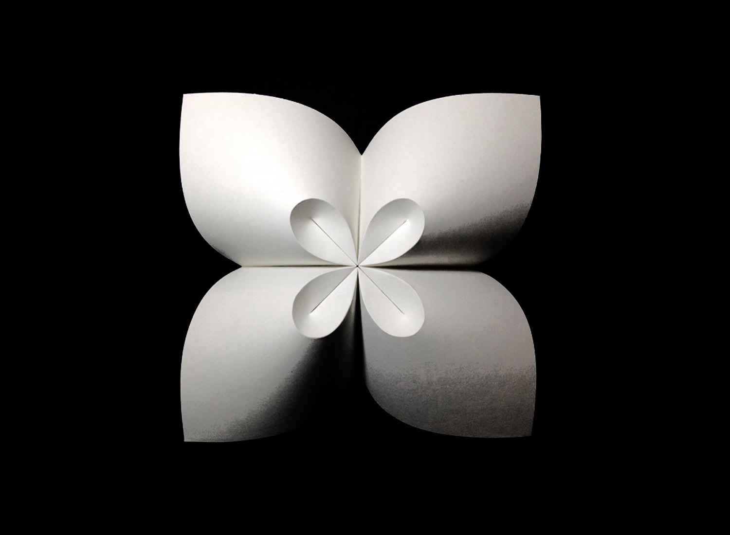 white cloverleaf origami by robby kraft, inspired by David Huffman