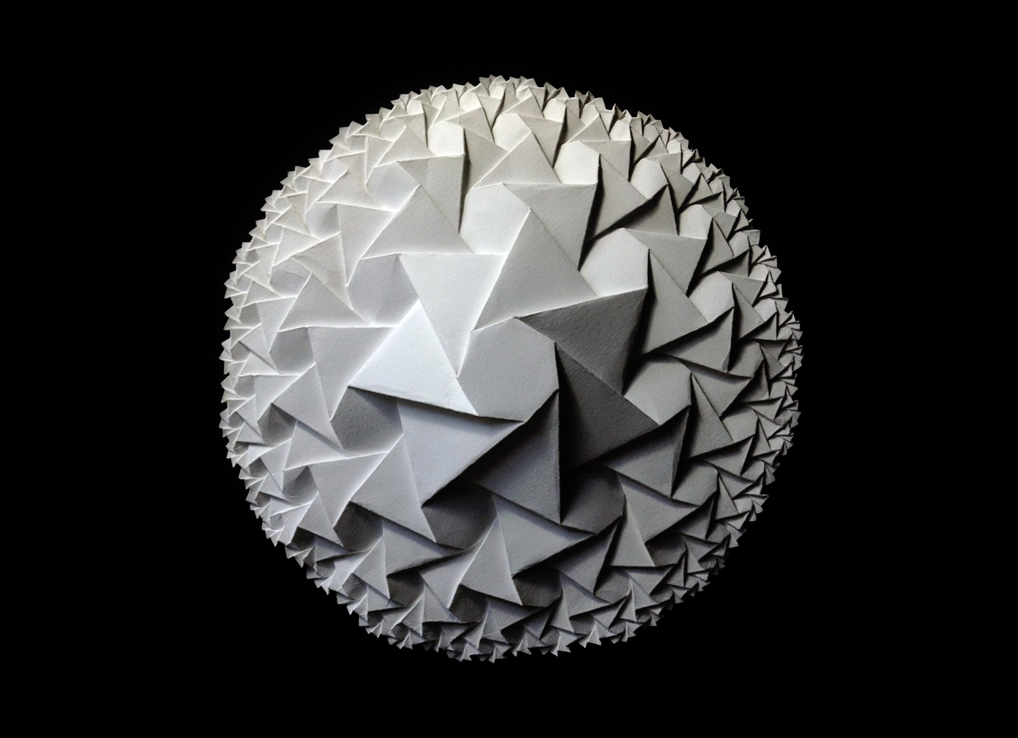 Origami and Mathematics Go Hand and Hand: The Paper Sculptures of Robby Kraft