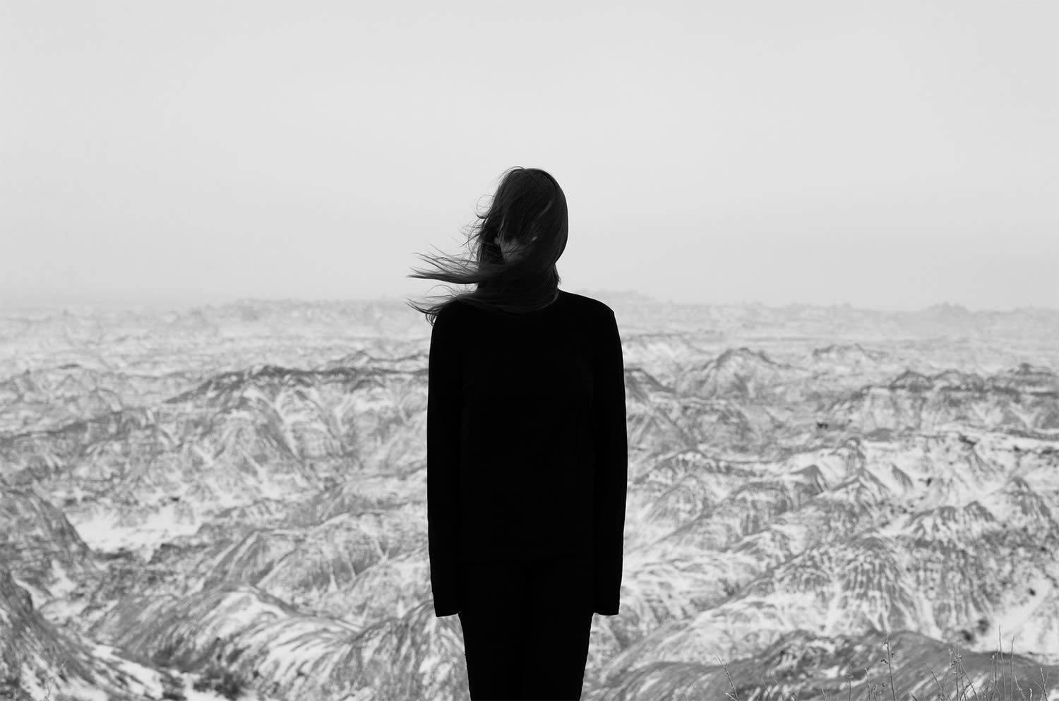 black and white photo, girl in front of canyon