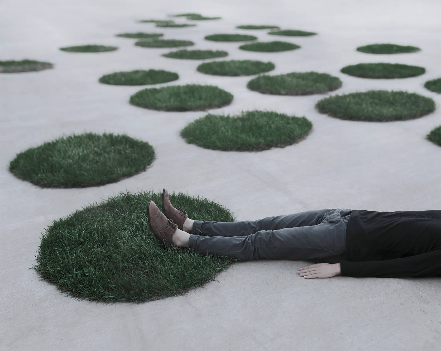 man lying on ground. photography