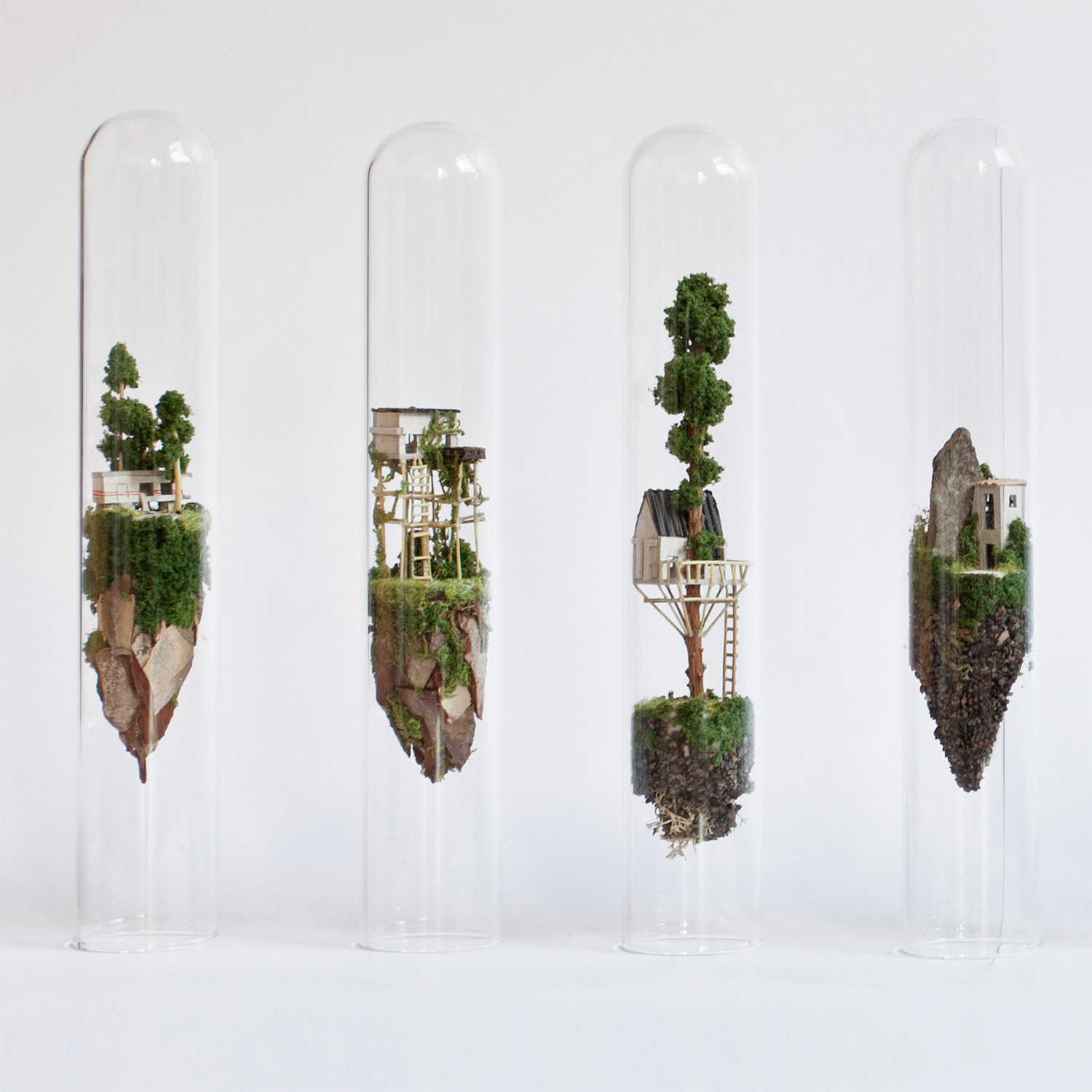 miniature sculptures in glass test tubes