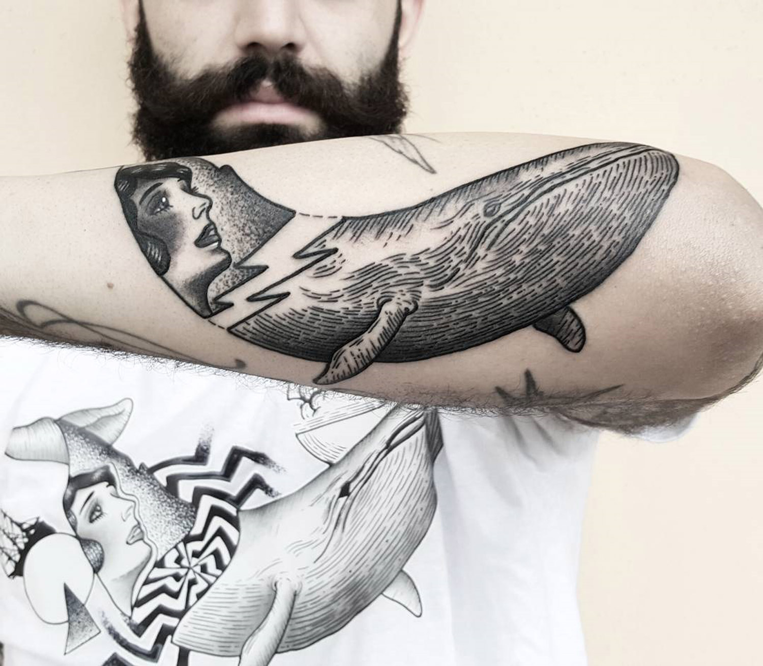portrait of woman in the tale of a whale on forearm by matteo nangeroni