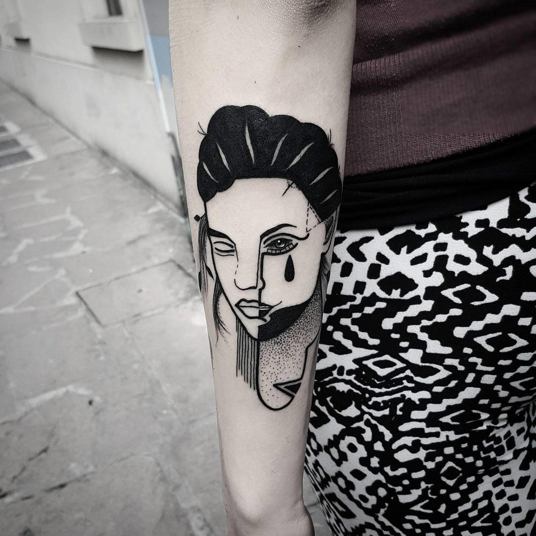 portrait of a woman with tear on cheek by matteo nangeroni