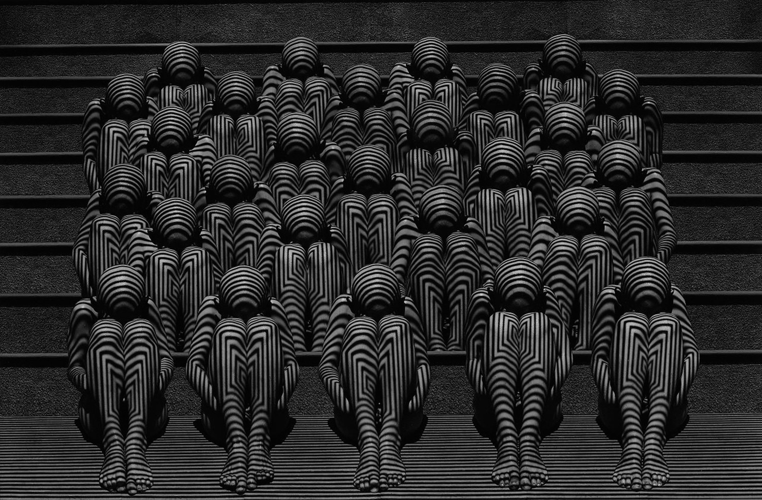 Misha Gordin - crowd on stairs with geometric patterns