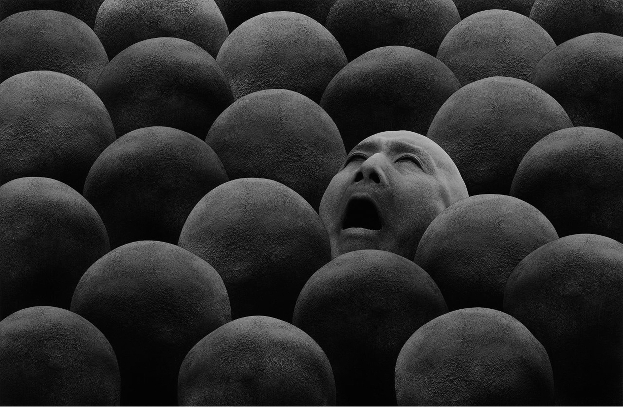 Misha Gordin - screaming face among bald heads