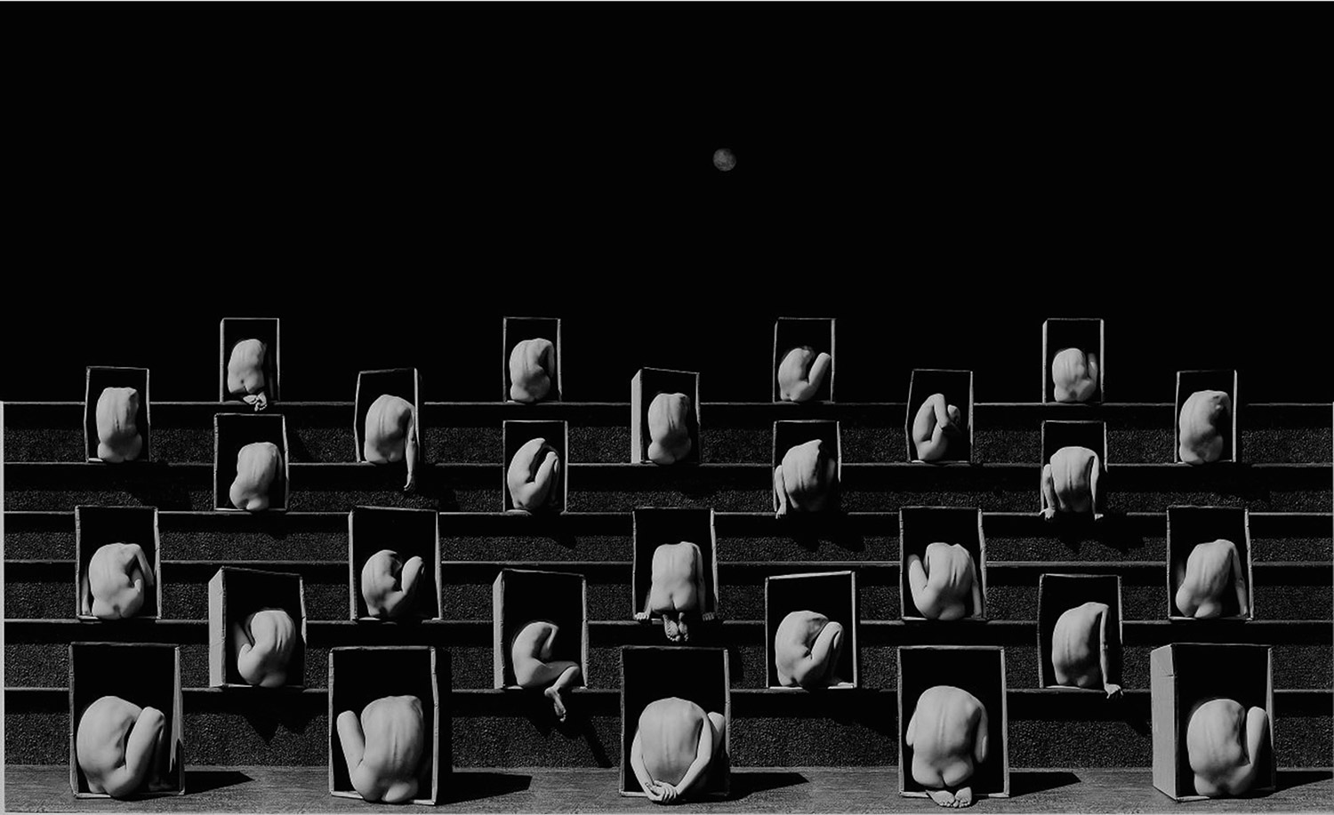 Misha Gordin - crouching figures in box frames on stairs