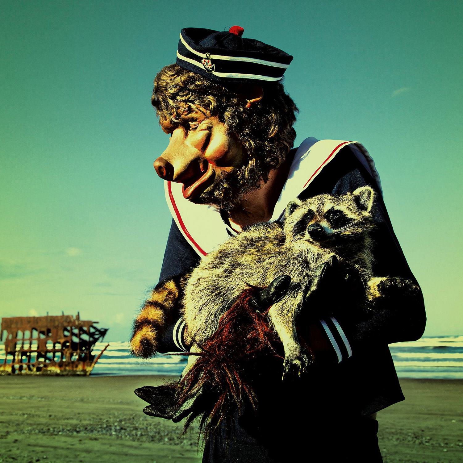 Mothmeister - masked figure with raccoon
