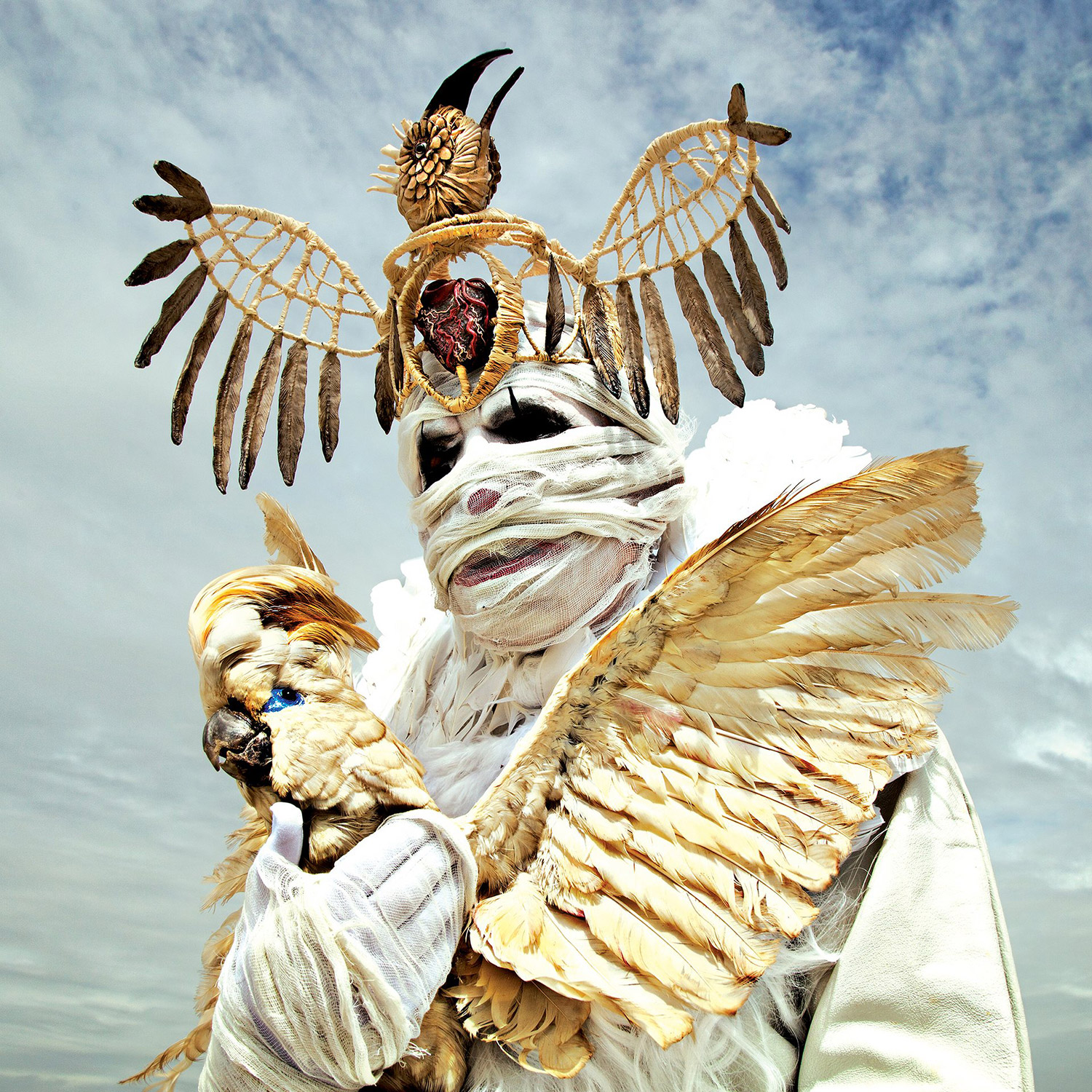 Mothmeister - white crowned figure with bird