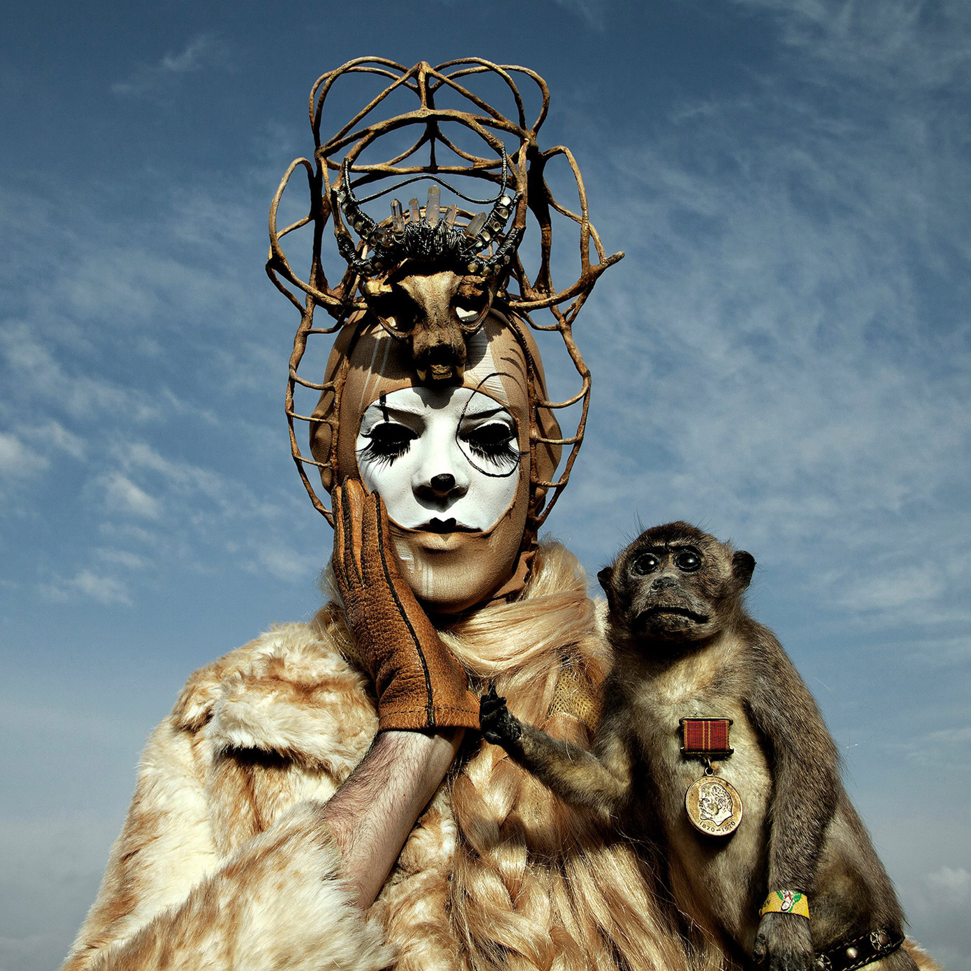 Mothmeister - crowned figure with monkey
