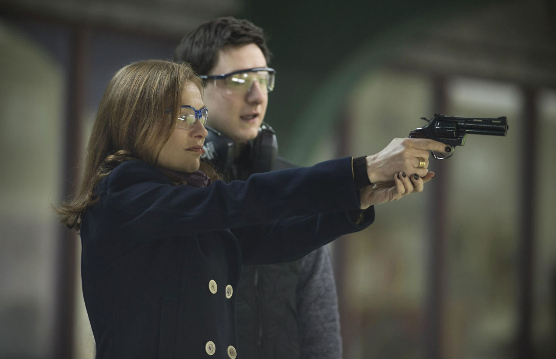 woman holding gun, Elle movie