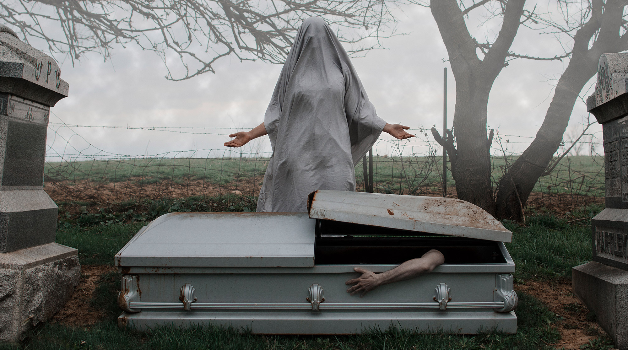 Christopher McKenney - white figure over opening coffin