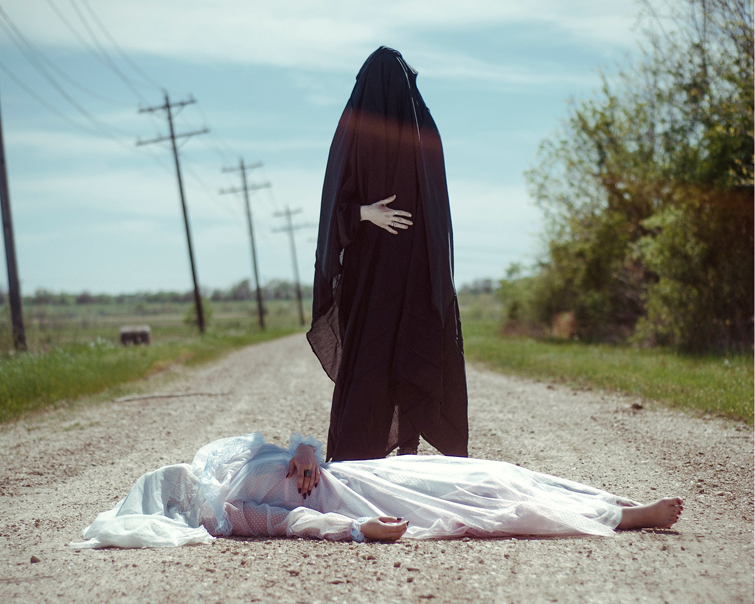 Christopher McKenney - dark figure over shrouded body on road