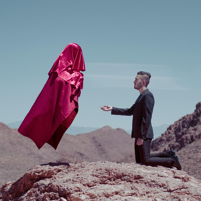 Christopher McKenney - floating red figure and kneeling man