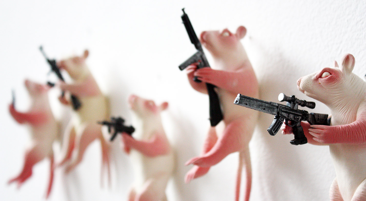 Erika Sanada - rodents with machine guns on wall