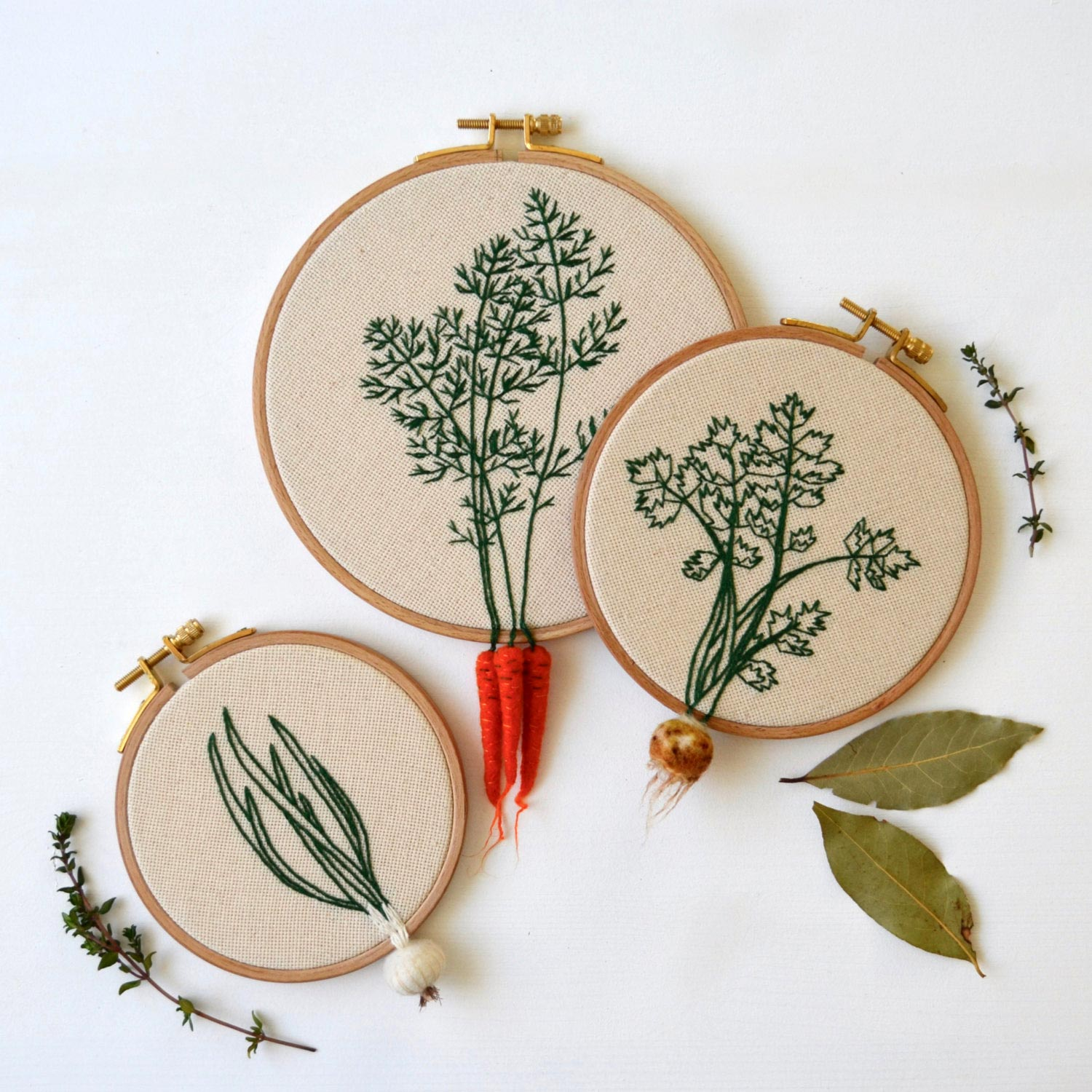 carrots and onions hanging outside of embroidery hoop by carrot hoop art by veselka bulkan