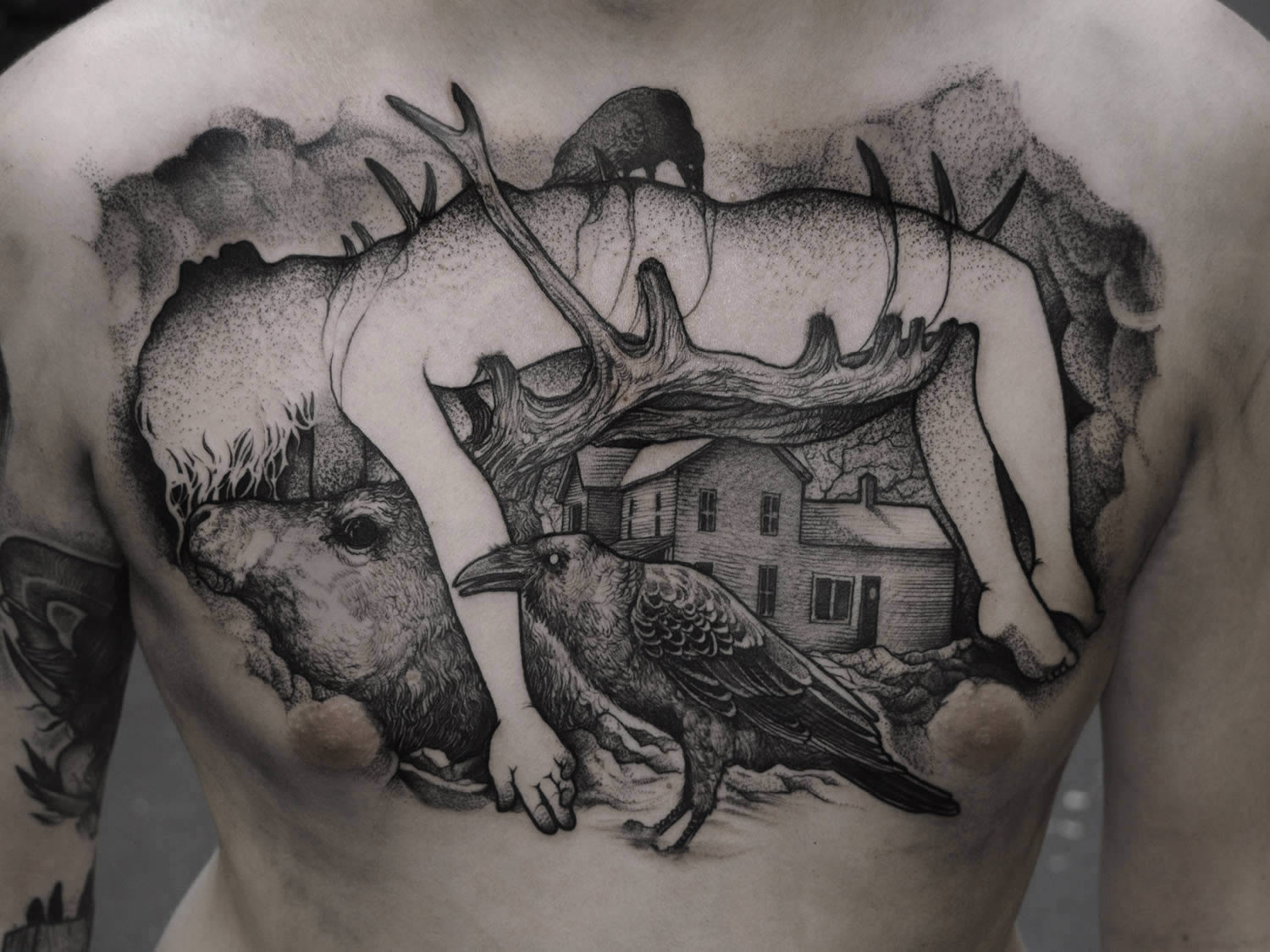 back tattoo - girl impaled on antlers
