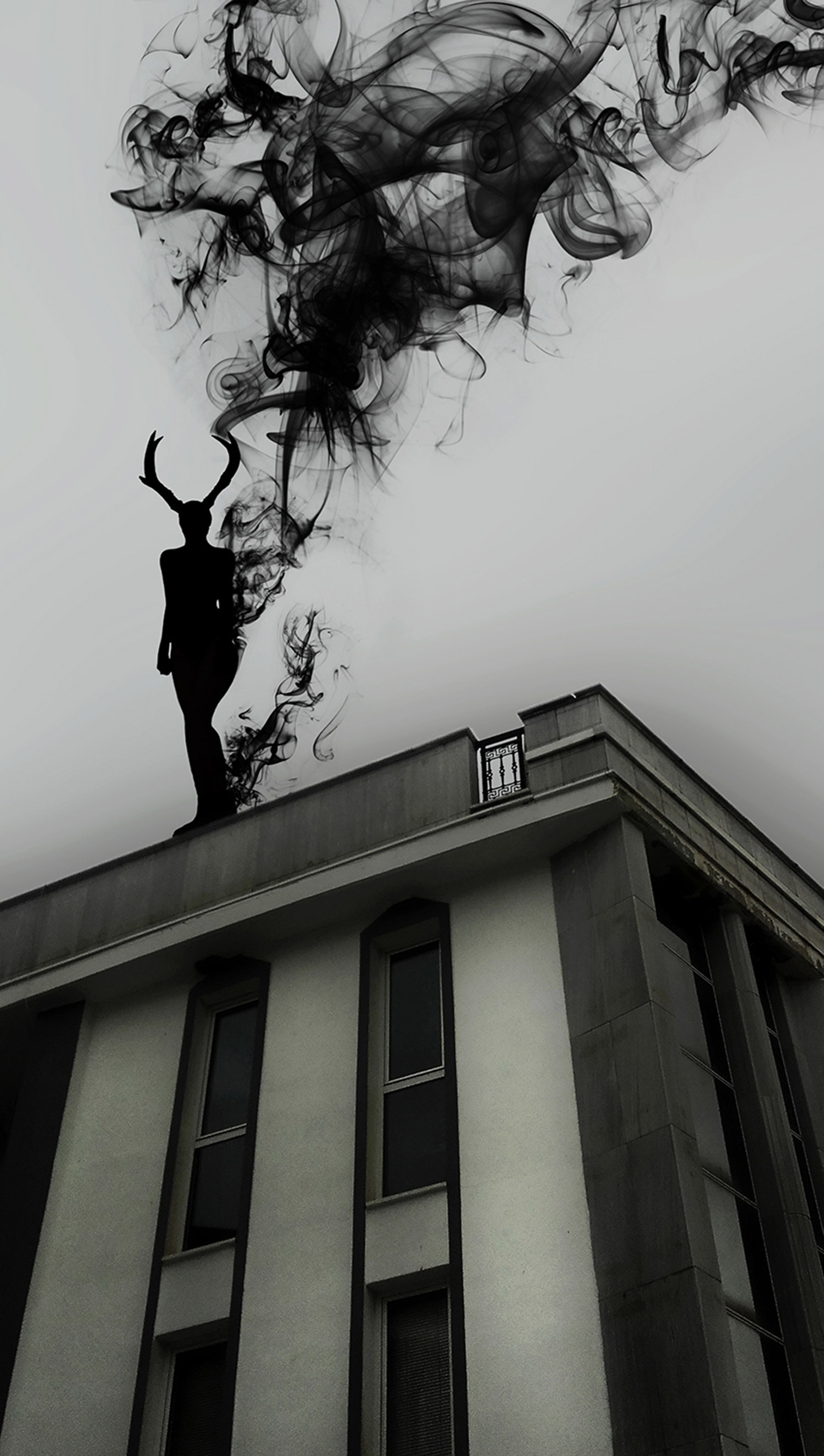 Valeria Chorozidi - ominous dark figure on building