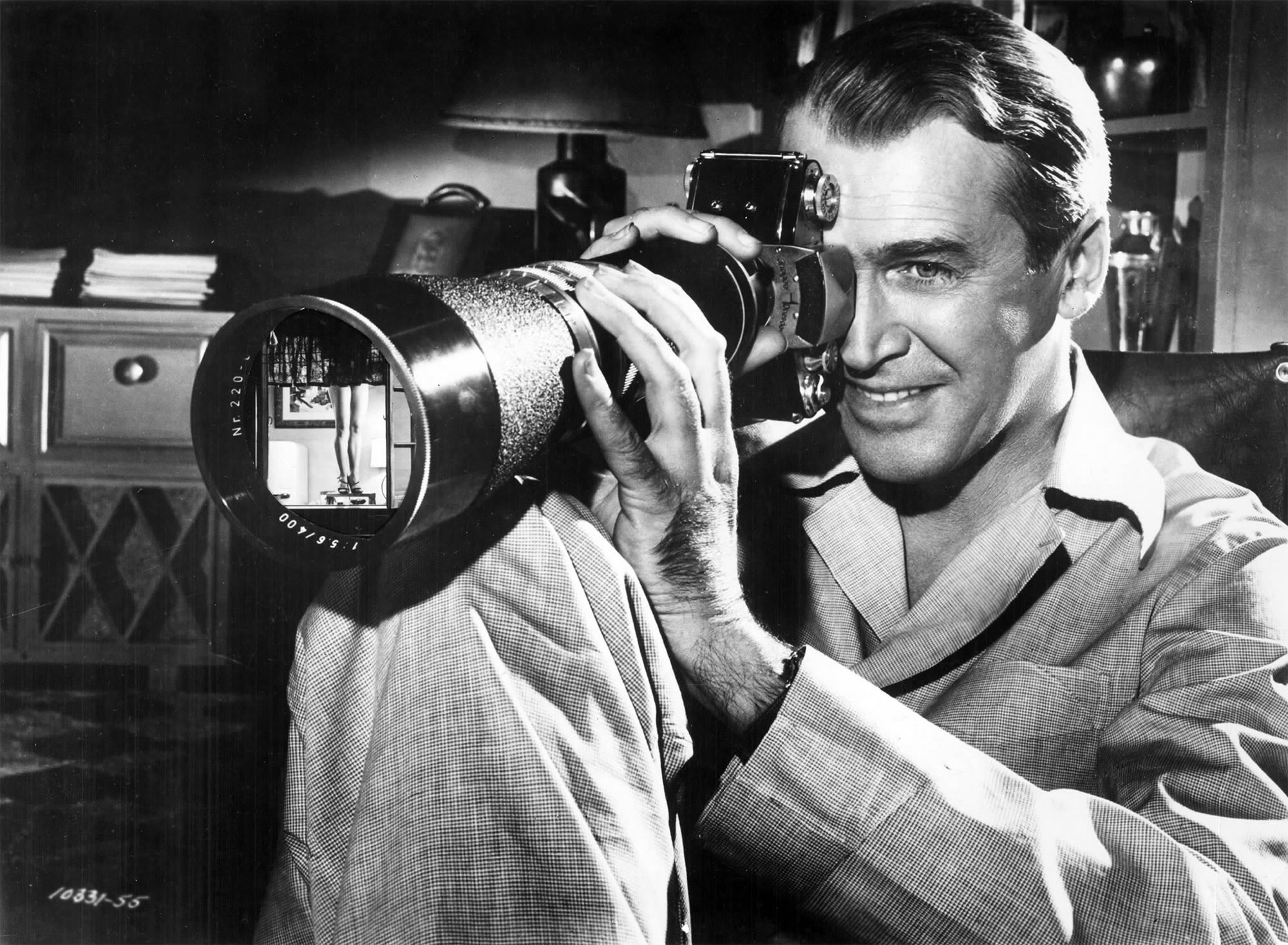 Rear Window, 1954. large lens camera, stalking