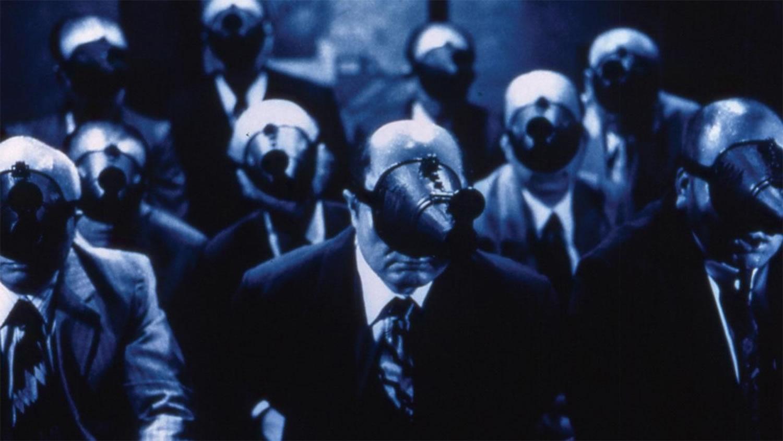 A Snake of June, blue image, men with weird masks, voyeurs