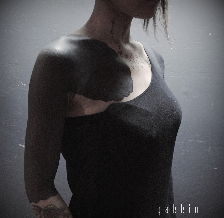bold black tattoo on arm