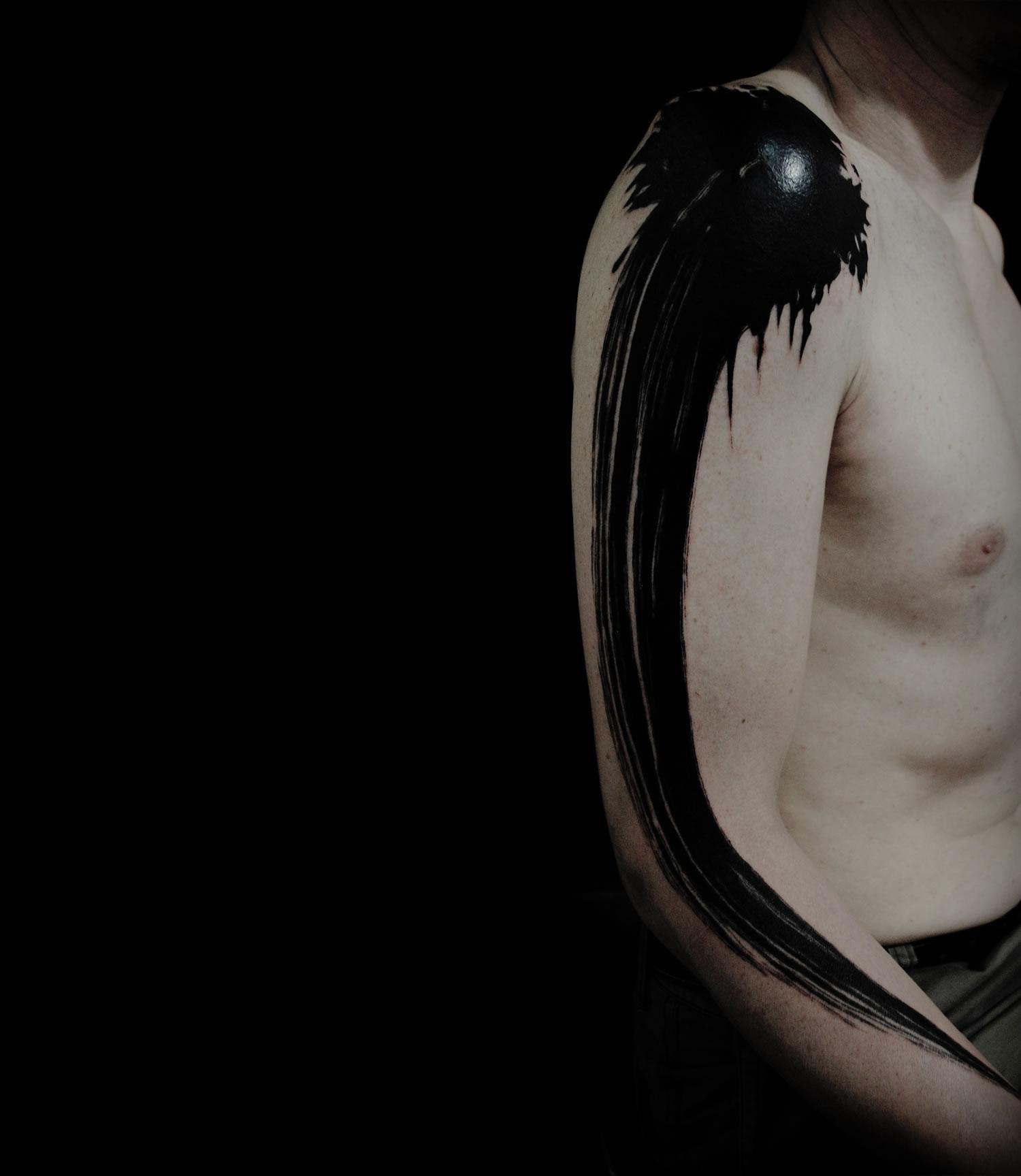 ink painting tattoo on arm, black ink