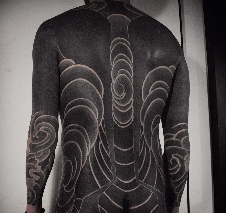 bold black tattoo on torso