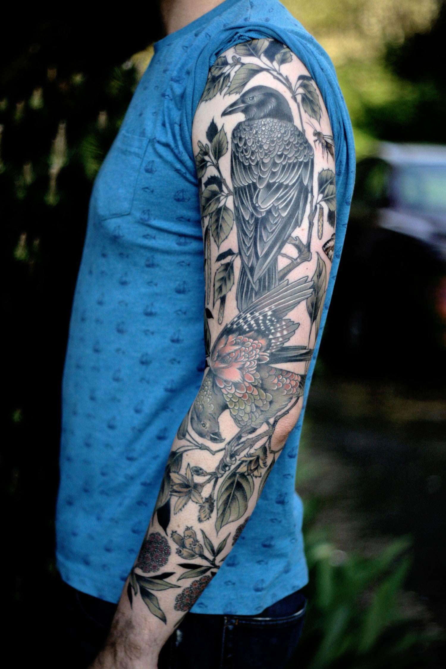 full tattoo sleeve, birds and plants