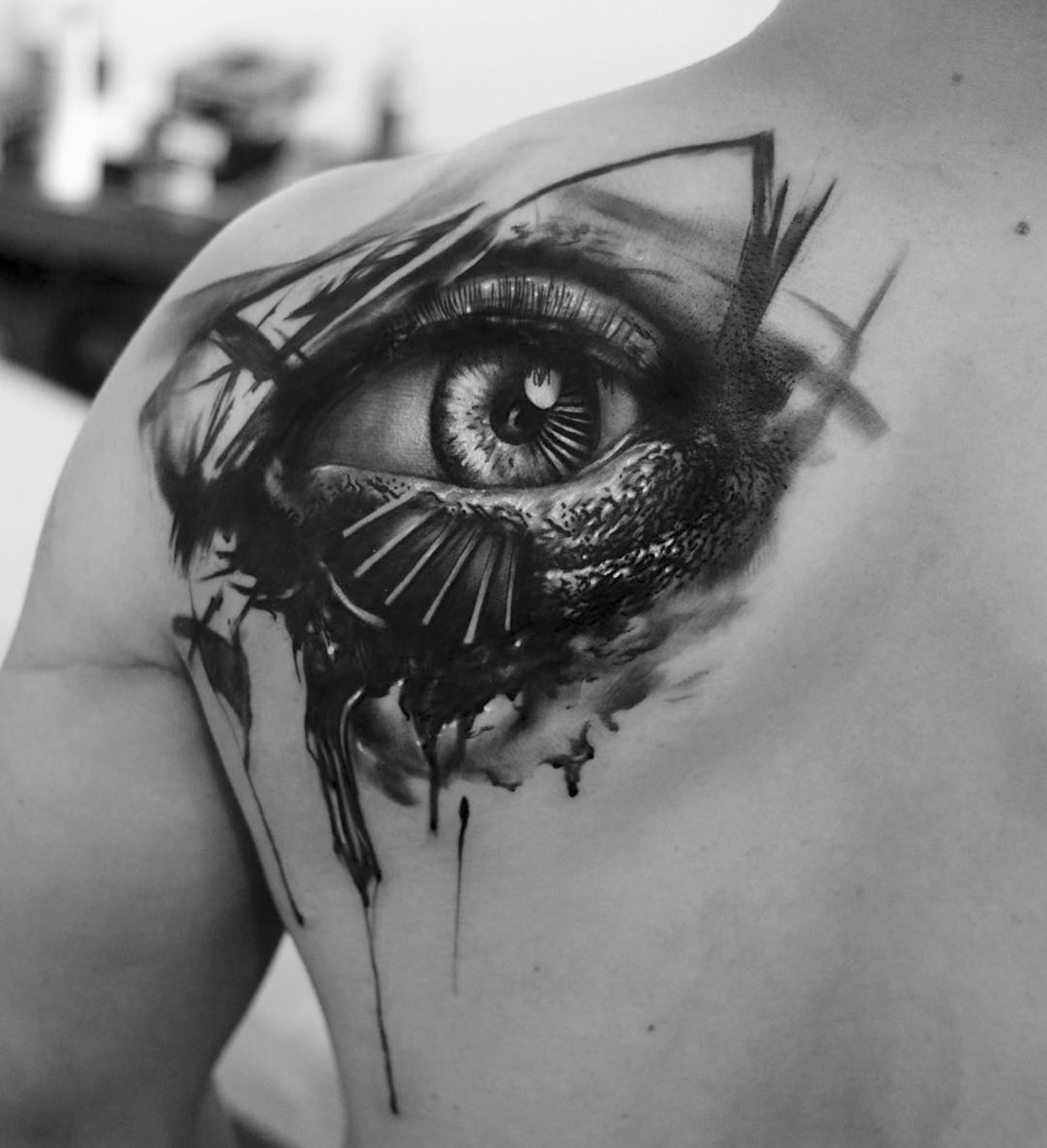 eye tattoo on back, abstract style