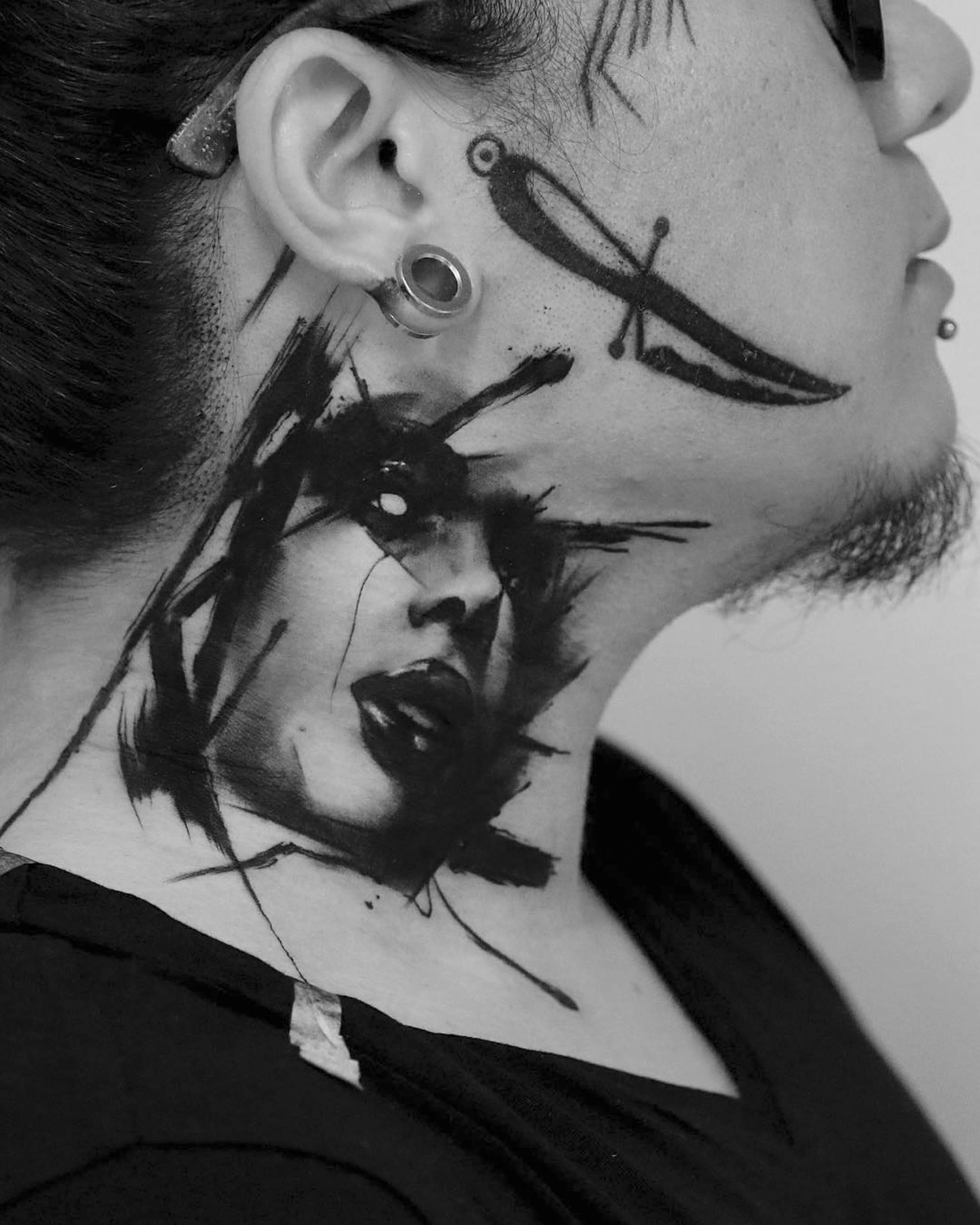 tattooed portrait on neck by kurt staudinger