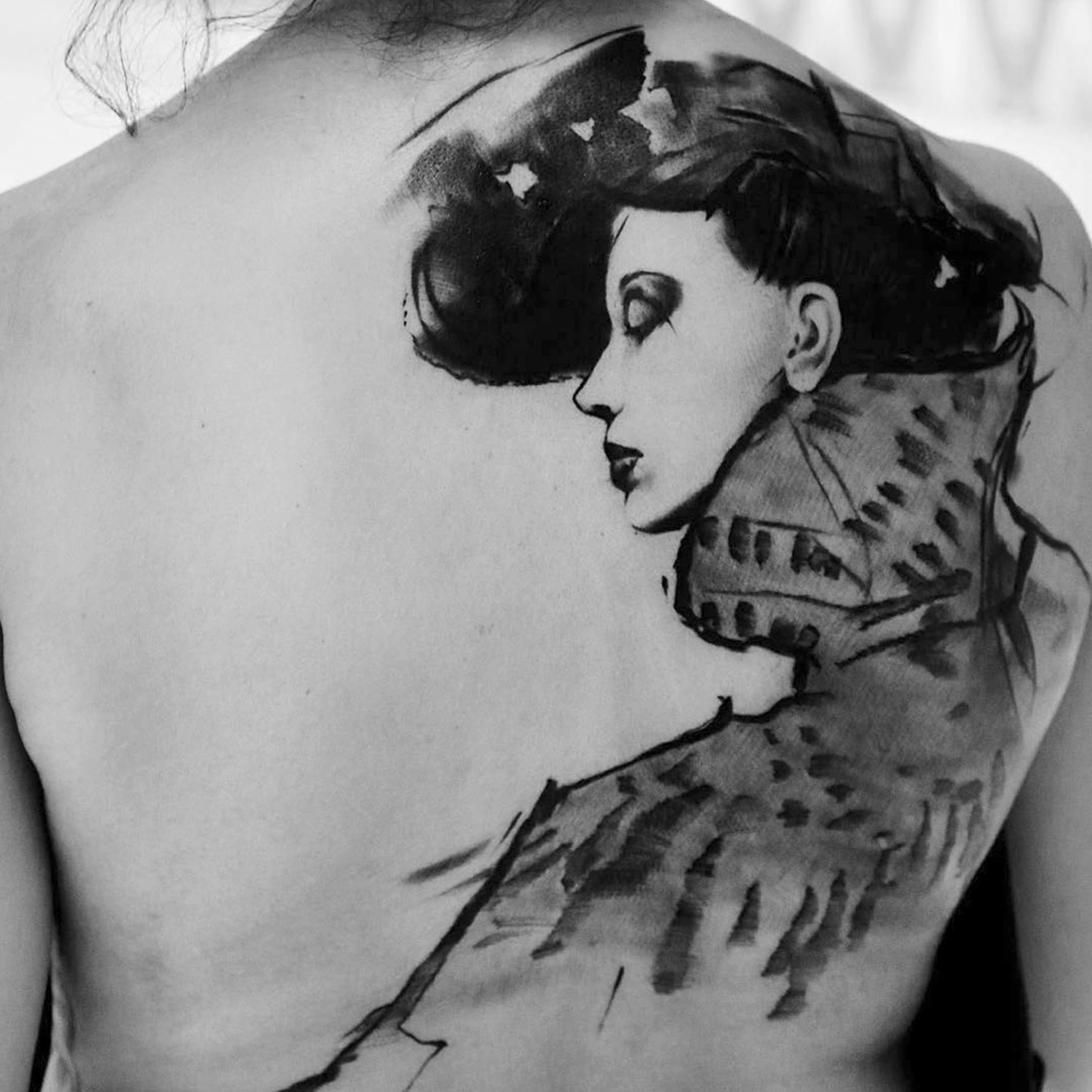tattoo of a woman on back by kurt staudinger