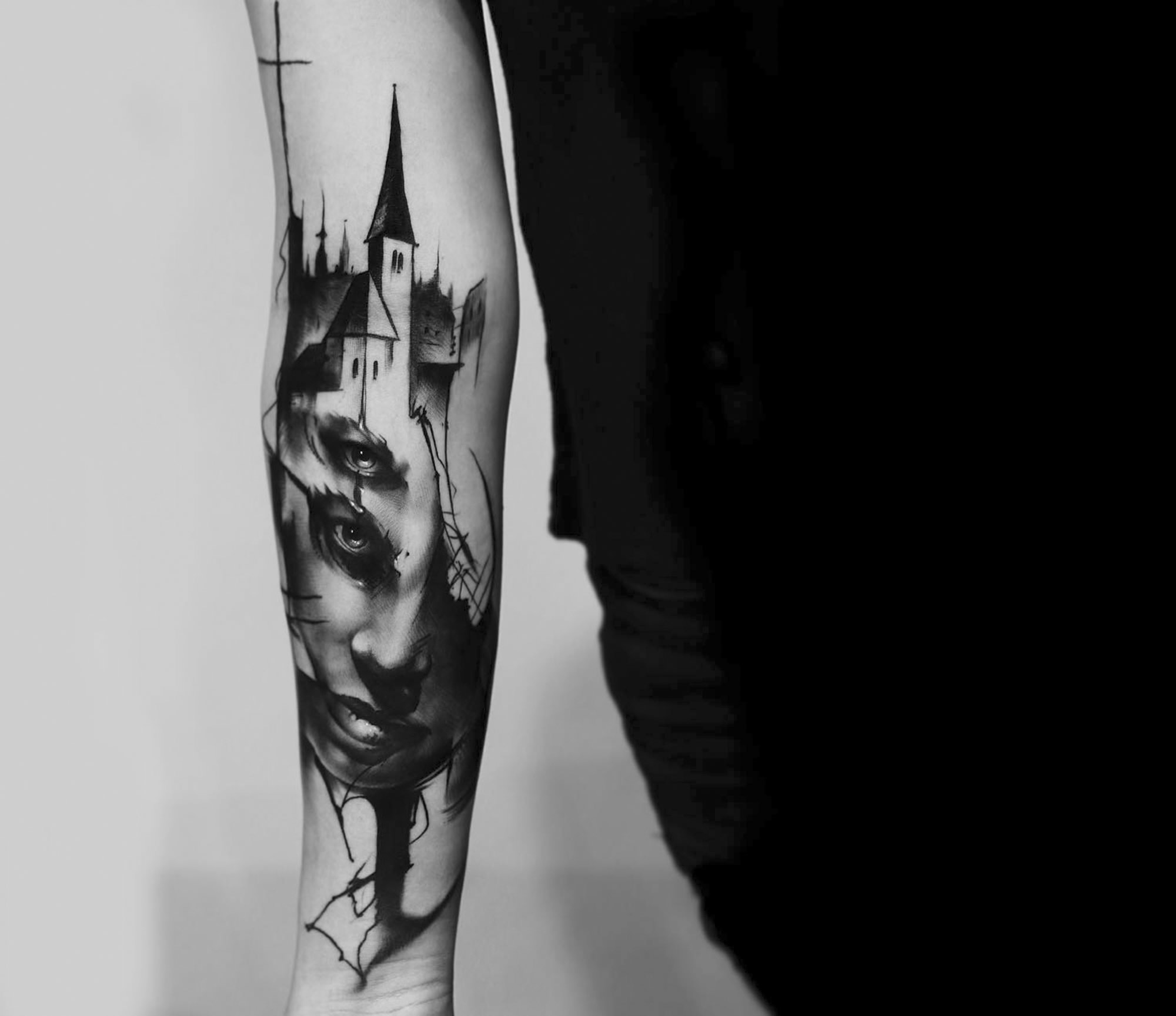 tattooed portrait on arm by kurt staudinger