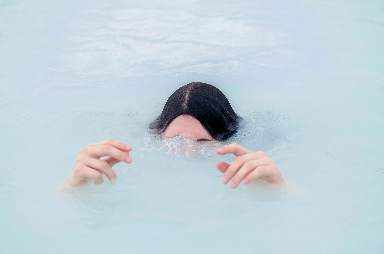 Brooke DiDonato - submerged in blue water