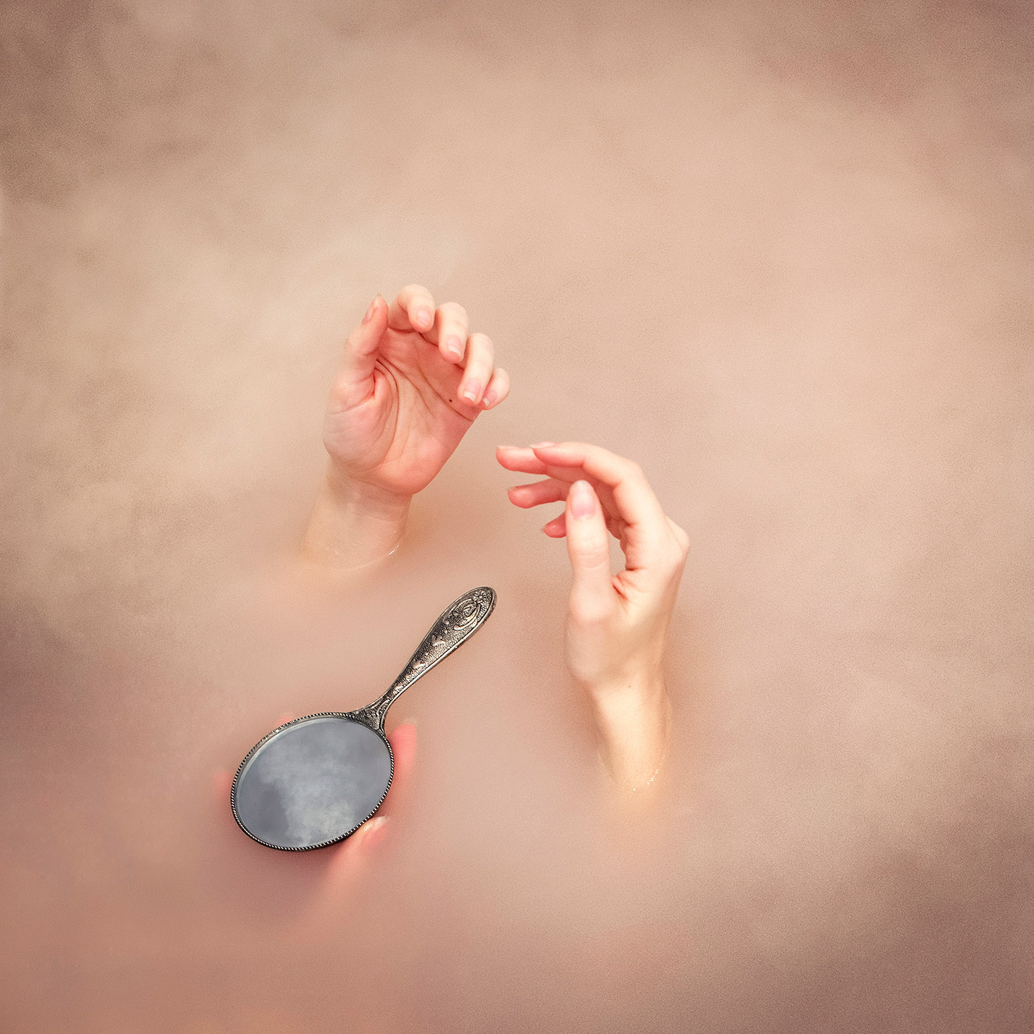Brooke DiDonato - hands and mirror in pink water