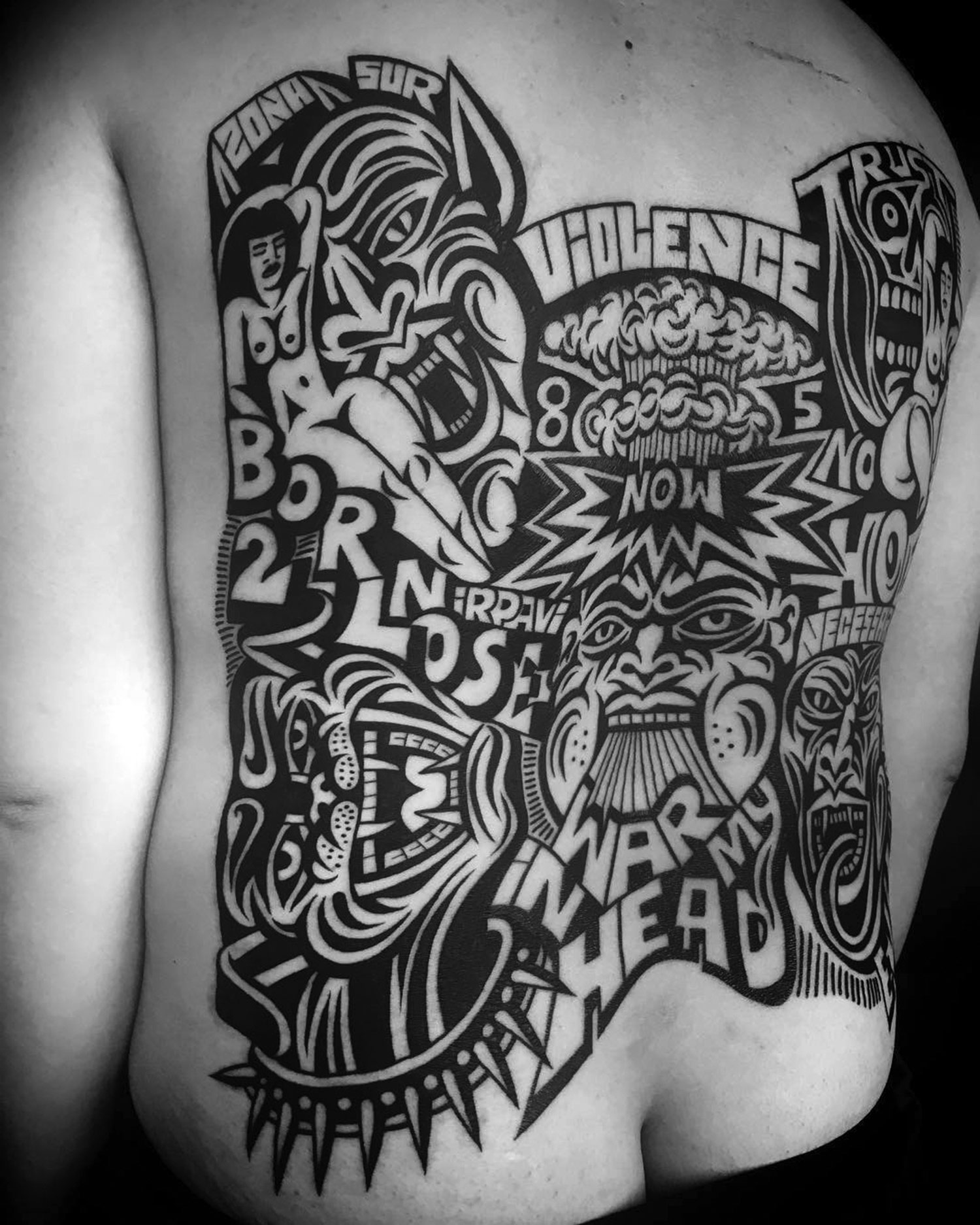 text-heavy back tattoo by by luxiano street cassic