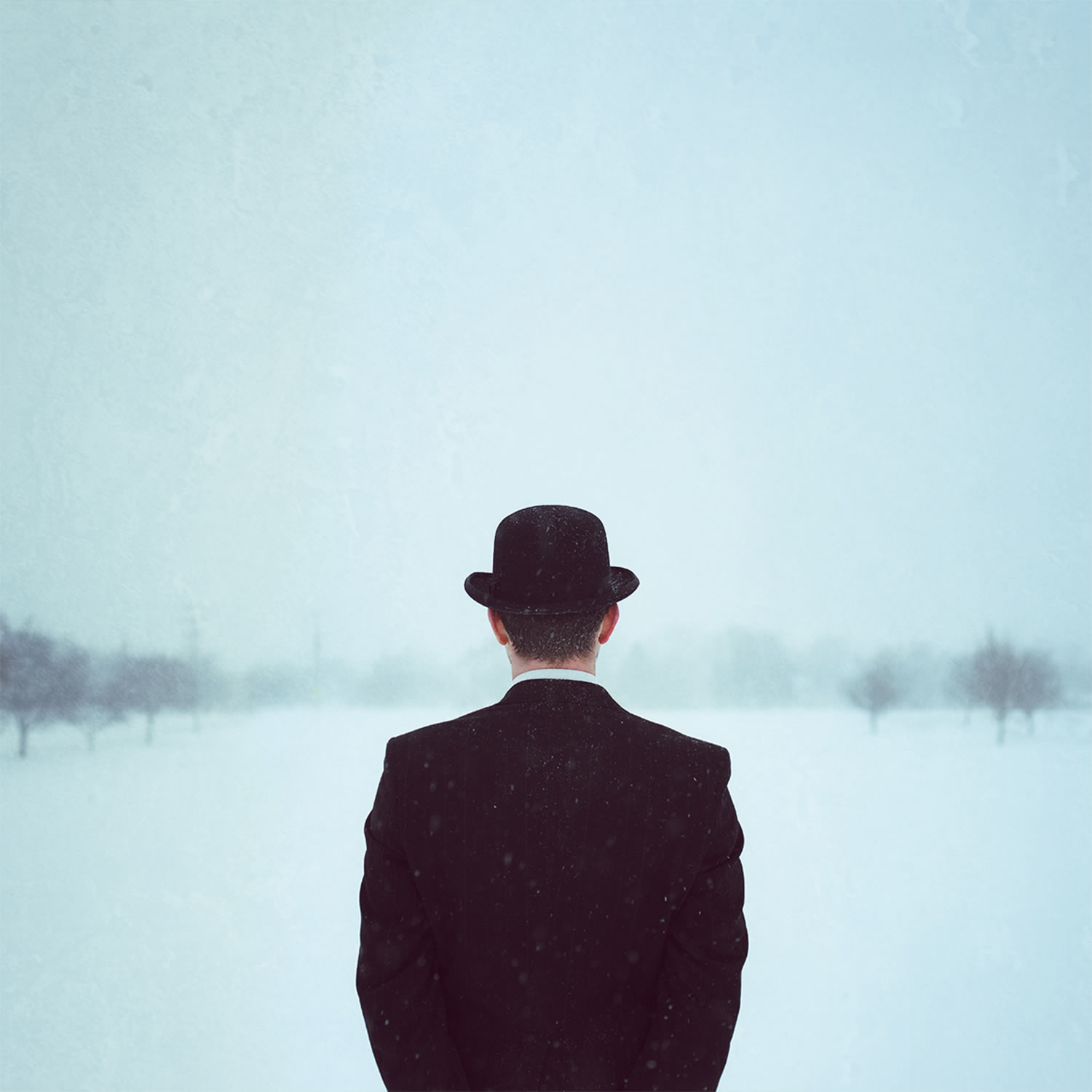 man with bowler hat, by logan zillmer