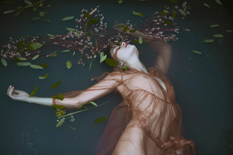 Monia Merlo - woman in dress in dark lake