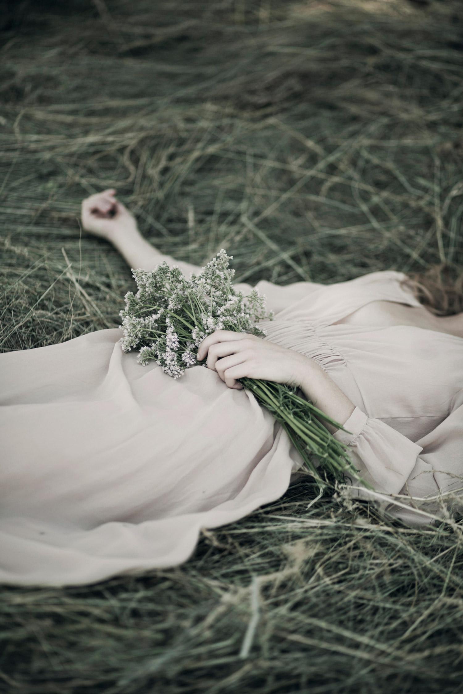 Monia Merlo - lying on grass