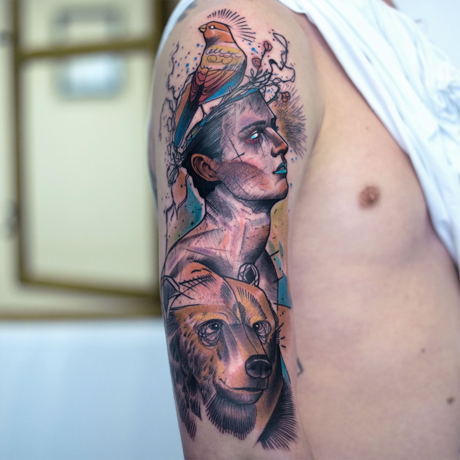 man and bear tattoo on arm