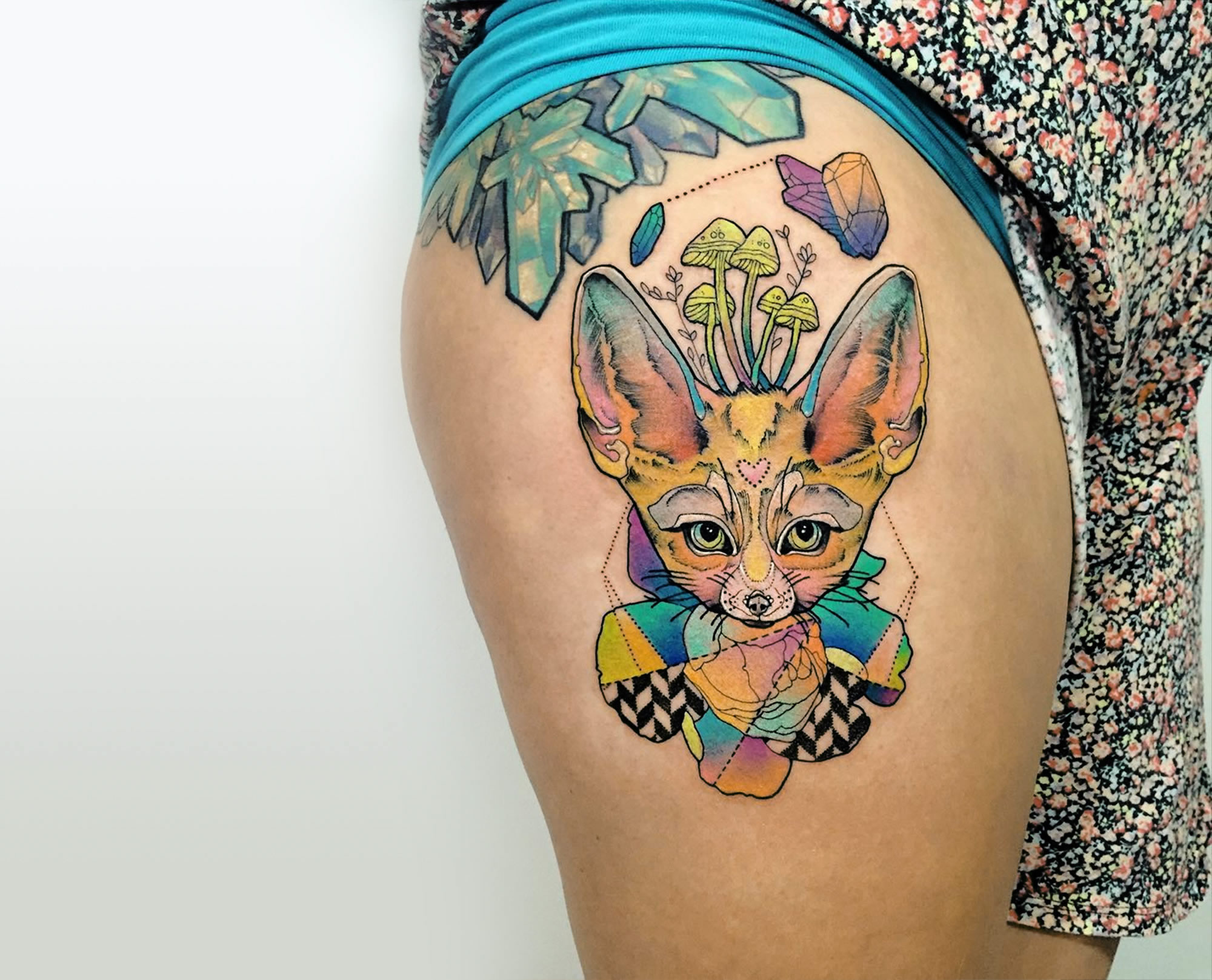 rainbow colored fox, tattoo on leg