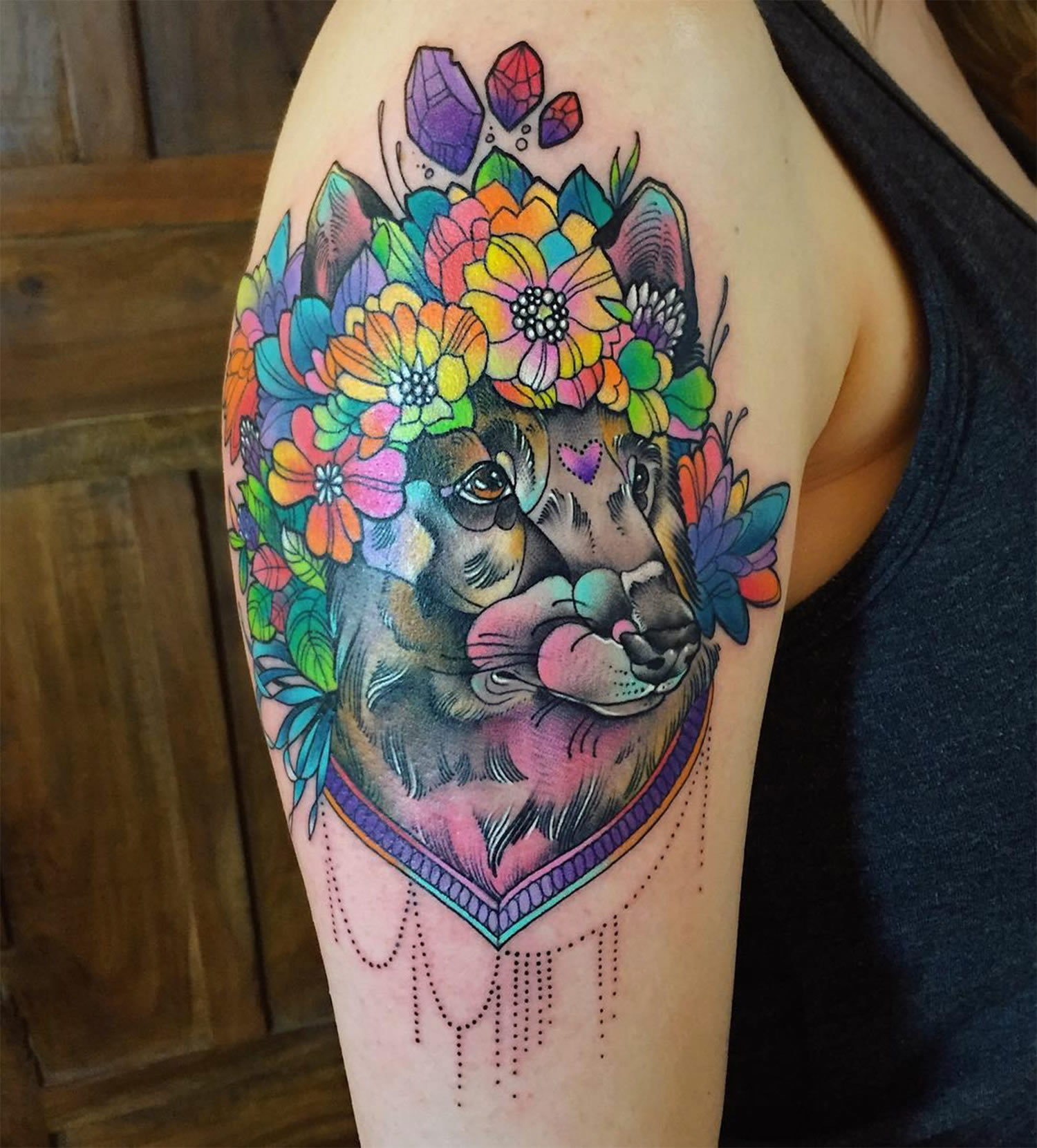 flowers on dog's head,. tattoo on arm