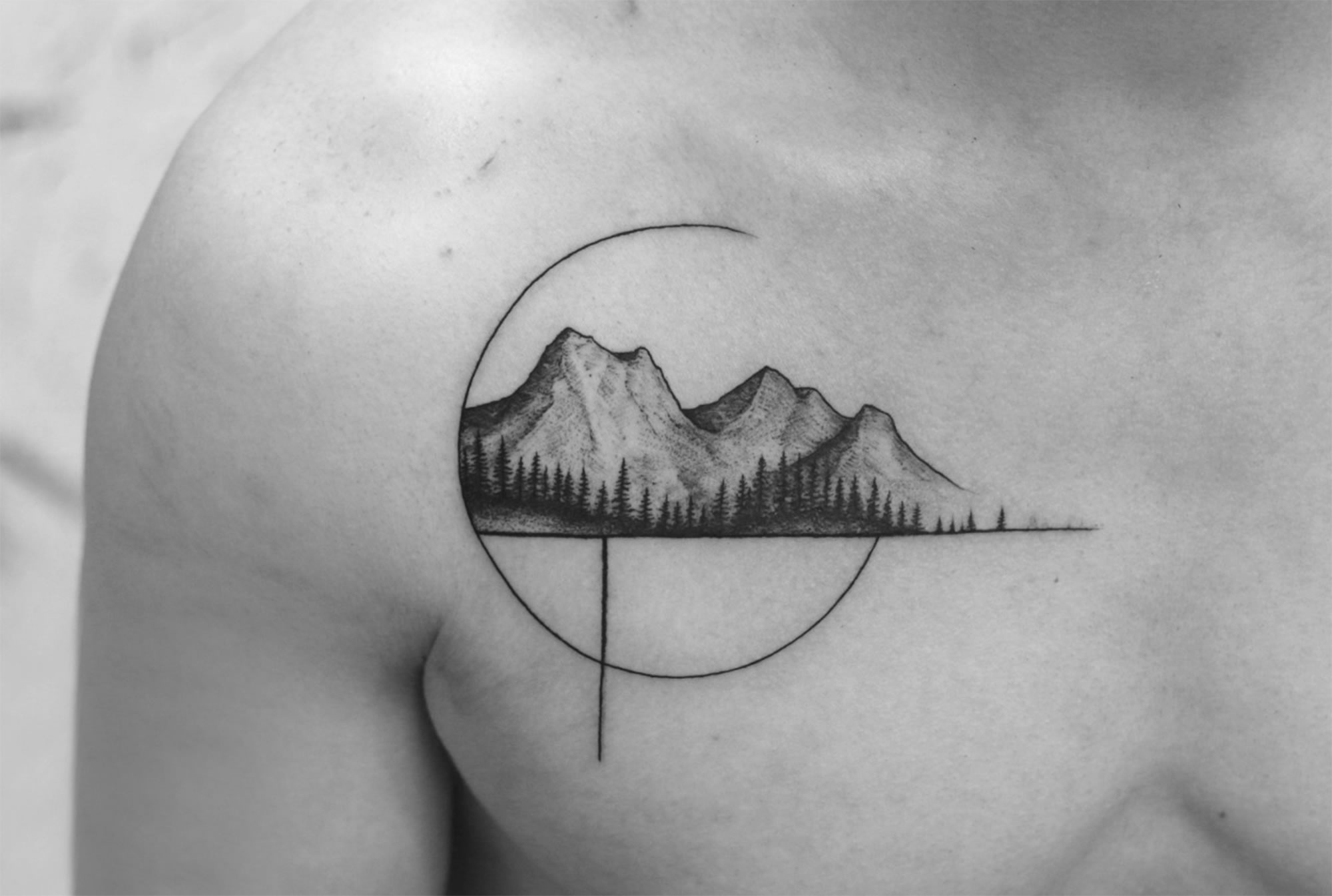 mountain landscape tattoo, black ink, chest