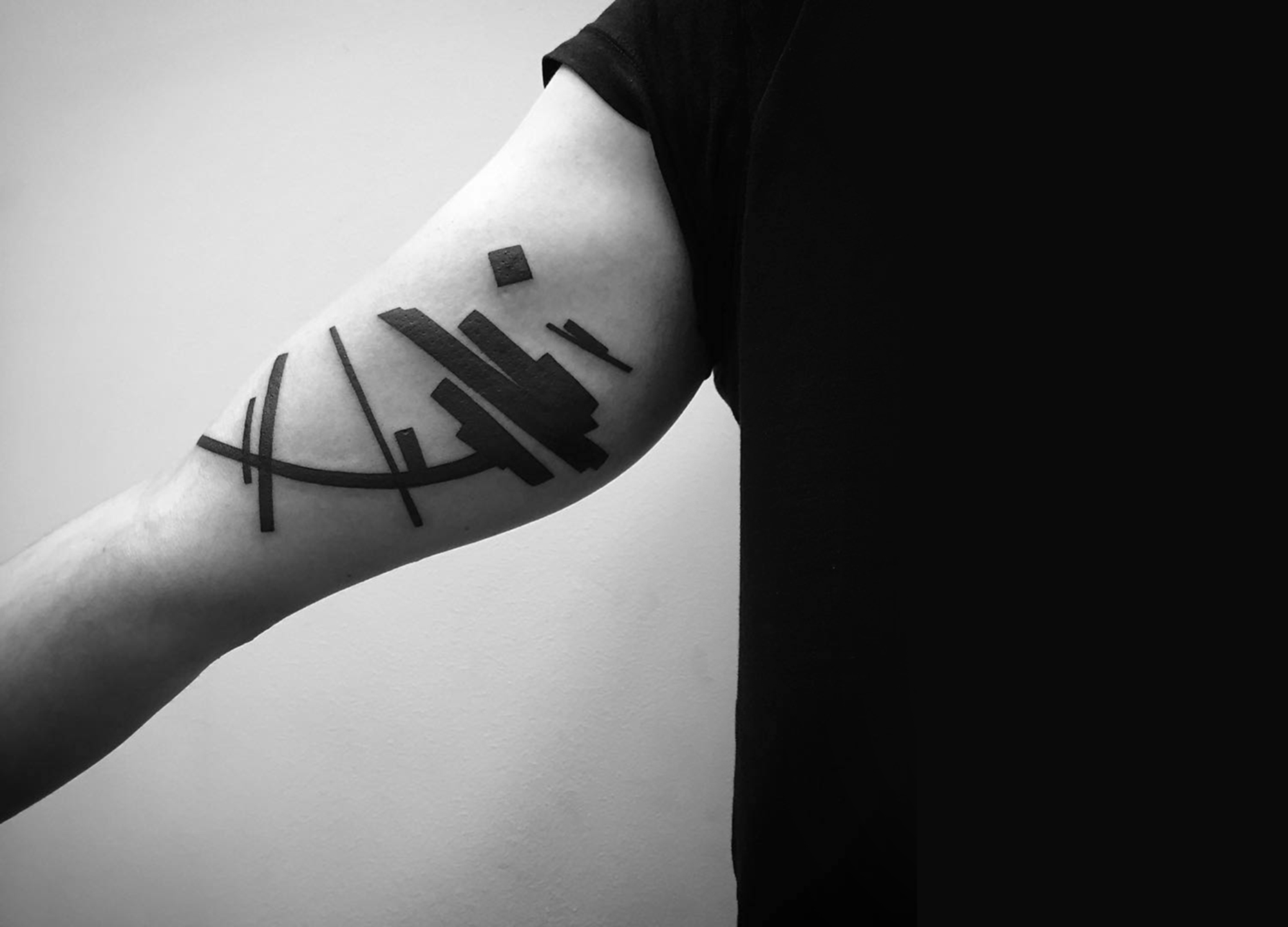 abstract tattoo on arm by stanislaw wilczynski