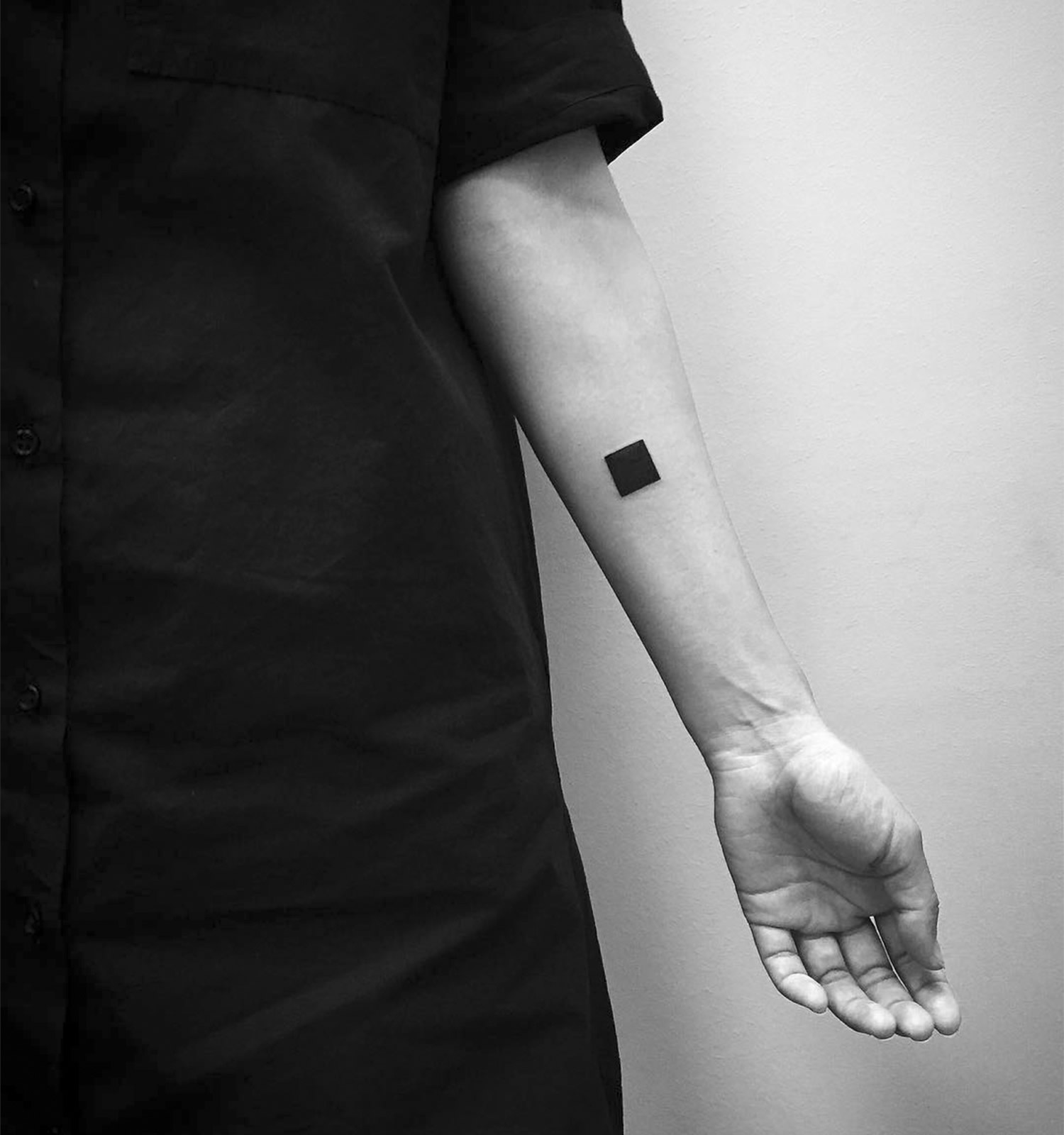 one black square on arm